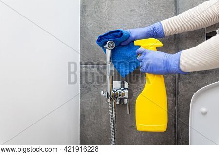 Hands In Protective Gloves Cleaning Hygienic Shower In Sanitary Room
