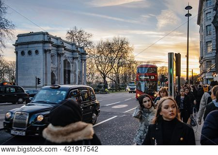 London, United Kingdom - Mar 9, 2017: Double Decker Bus, Hackney Carriage Taxi And Pedestrians With