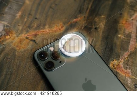 Paris, France - May 2, 2021: Macro Close-up Of New Airtag Above Avove Iphone 12 Pro Focus On Ultra W