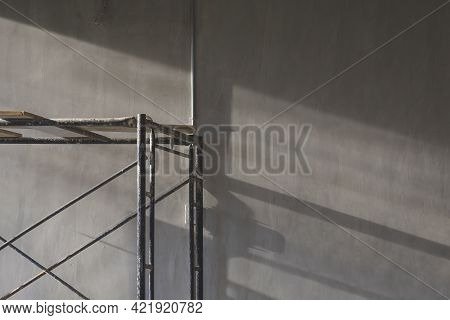 Evening Sunlight And Shadow On Surface Of Scaffolding With Electrical Conduit Pipe On Loft Cement Wa