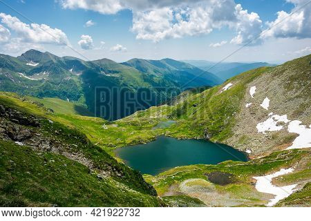 Capra Lake Of Fagaras Mountains. Wonderful Summer Nature Scenery On A Sunny Day. Popular Travel Dest
