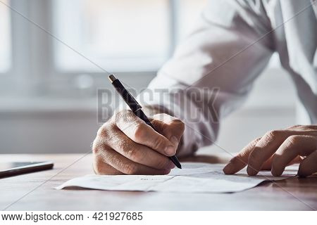 Business man signing document close up. Business man signing contract. Signature. Business manager signing document. Businessman. Business Contract signature. Business deal. business contract