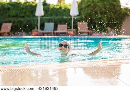 Happy Beautiful Girl Having Fun At The Pool