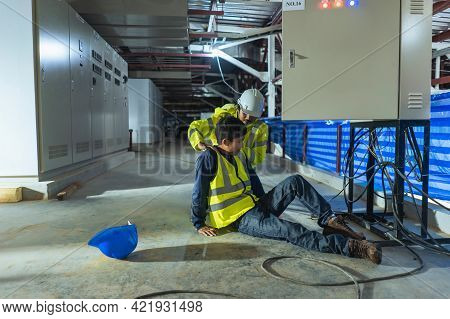 Supervisor First Aid Maintenance Worker Accident Electric Shock Unconscious. Asian Electrician Worke