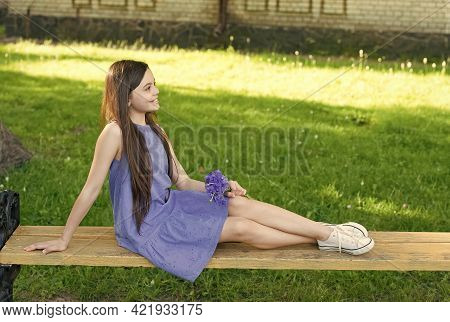 Great Time To Enjoy The Outdoor. Happy Girl Relax On Bench Outdoor. Summer Vacation And Holidays. En