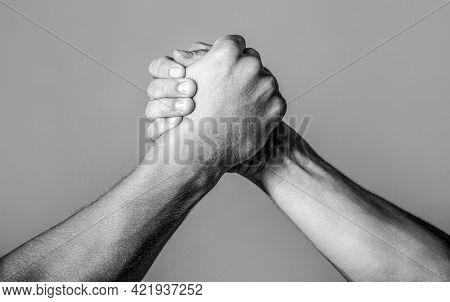 Friendly Handshake, Friends Greeting, Teamwork, Friendship. Handshake, Arms, Friendship. Hand Rivalr