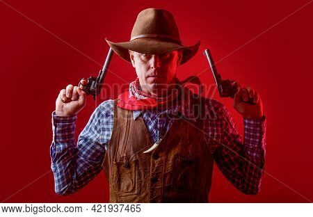 Man Wearing Cowboy Hat, Gun. Portrait Of A Cowboy. West, Guns. Portrait Of A Cowboy. Western Man Wit