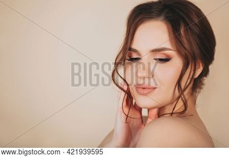 Side View Of Delighted Young Female In Trendy Outfit Smiling Wavy Hair And Looking At Camera Against
