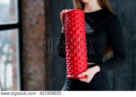 A Girl In A Sports Uniform Holds A Fascia In Her Hands Preparing For A Workout In The Gym