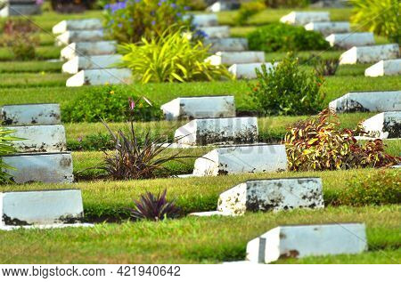 Labuan,malaysia-april 25,2021:war Cemetery With Rows Of White Cement Graves In Commonwealth World Wa