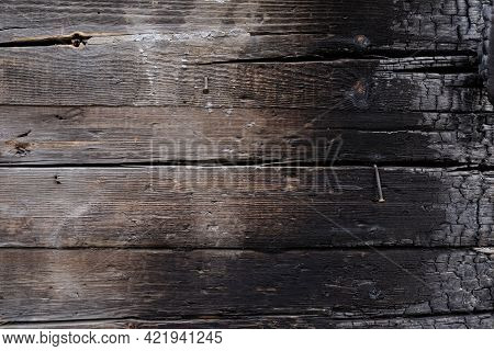 Texture Partially Burnt Wood. Charred Board. Firewood