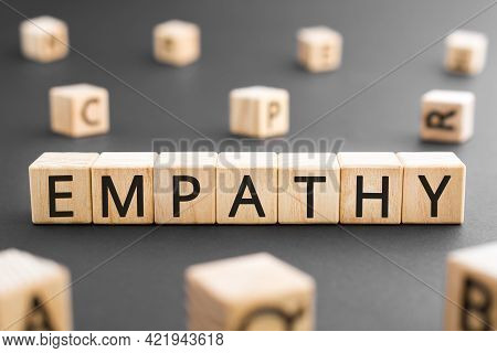 Empathy - Word From Wooden Blocks With Letters, Empathy Concept, Random Letters Around Black Backgro