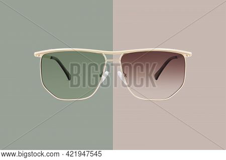 Sun Glasses Golden Metallic Frame And Green And Brown Gradient Polarized Lenses Isolated On Backgrou
