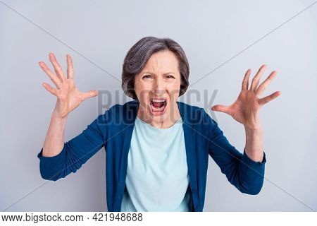 Photo Of Furious Angry Age Woman Wear Blue Cardigan Screaming Rising Arms Isolated Green Color Backg