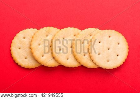 Cracker Close-up. Salty Cracker On A Red Background