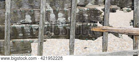 Close Up Of Decaying Cross Timbers Of Old Nautical Vessel
