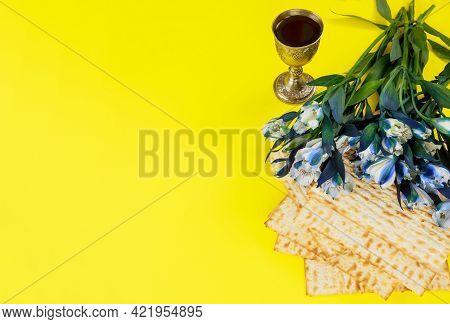 Passover Symbols Matzoh, Red Wine And Flowers. Jewish Holiday.