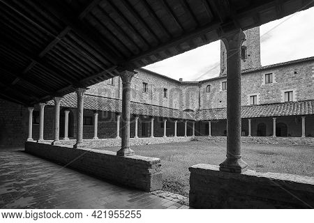 Courtyard With Cloisters Of A Historic Monastery In The City Of Massa Maritima In Tuscany, Monochrom