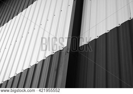 Details Of Black And White Corrugated Iron Sheet Used As A Facade Of A Warehouse Or Factory. Texture