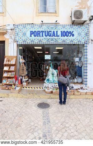 Albufeira, Portugal - May 30, 2018: Shopper Visits A Souvenir Shop In Downtown Albufeira, Portugal.