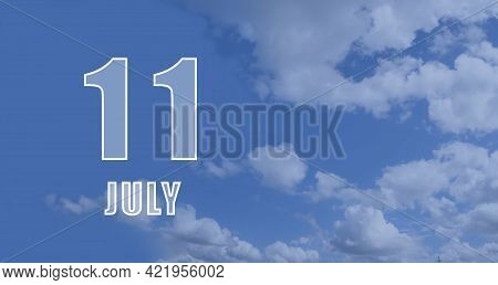 July 11. 11-th Day Of The Month, Calendar Date.white Numbers Against A Blue Sky With Clouds. Copy Sp