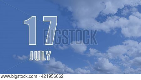 July 17. 17-th Day Of The Month, Calendar Date.white Numbers Against A Blue Sky With Clouds. Copy Sp