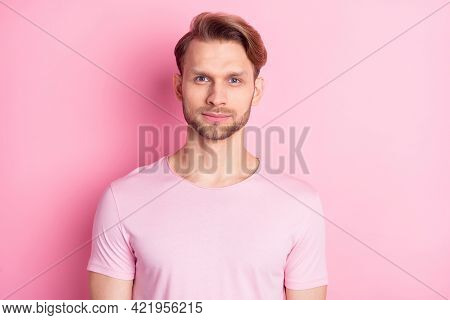 Photo Of Pretty Cute Serious Young Gentleman Dressed Casual T-shirt Isolated Pink Color Background