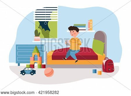 Cute Little Boy Is Sitting On Bed At Home In His Bedroom Using A Digital Tablet. Smiling Kid Enjoing