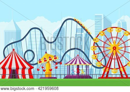 Amusement Park With Circus Carousels Roller Coaster And Attractions Entertainment In City. Fun Fair