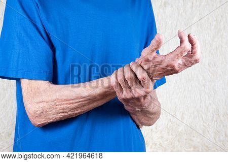 Male Hand Holding Wrist. Eldery Man Suffering From Pain In Hand. Bone Disease, Arthritis Or Arthrosi