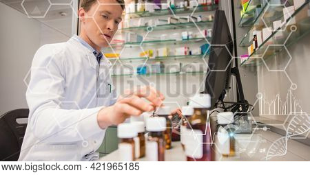 Composition of male pharmacist at work, with medical research data interface screen. global medicine, research and digital interface concept digitally generated image.