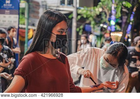 Bangkok/thailand-29/10/2020:anti-government Protester Paint Her Body With Blue Color On Silom Road I