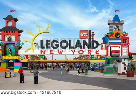 Brooklyn, Ny - April 24 2021: Visitors Pass Through The Colorful Entrance Gate To Legoland In New Yo