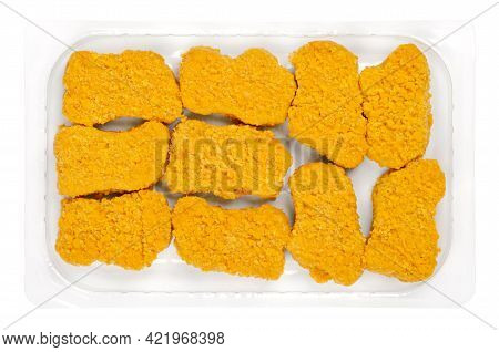 Vegan Nuggets, Ready To Fry In A Clear Plastic Container. Vegan Nuggets, Based On Soy And Wheat Prot