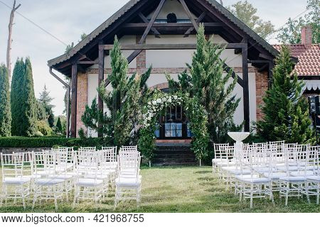 Wedding Decor, A Place For A Wedding Ceremony In Nature, In The Garden. Wedding Arch Made Of Fresh F