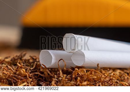Empty Cartridges With A Filter For Filling With Tobacco, Cigarettes On Tobacco Leaves