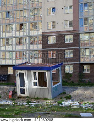 Old Broken Construction Shed At A New Modern Residential Building, Soyuzny Prospekt, Saint Petersbur