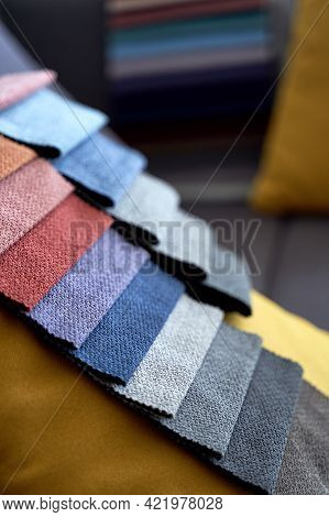 Colorful Upholstery Fabric Samples On The Sofa