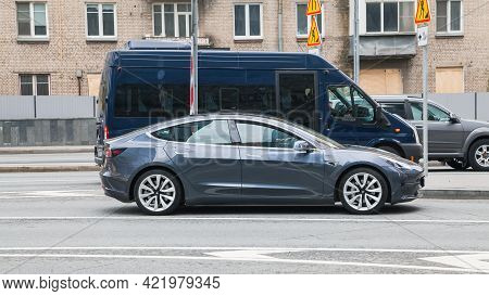 Moscow , Russia - April 2021: Gray Color Tesla Model 3 Car On Street. The Tesla Car Is All-electric