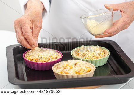 Senior Woman Preparing A Delicious Cheese And Ham Tartlet