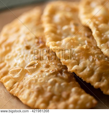 Delicious Fried Cheburek, Crispy Puff Pastry Stuffed With Meat Filling. Close Up Shot. Soft Focus. J