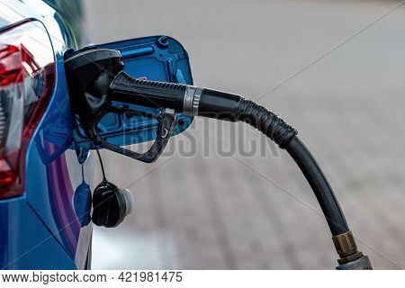 Refueling Car Fill With Petrol Gasoline At Gas Station And Petrol Pump Filling Fuel Nozzle In Fuel T