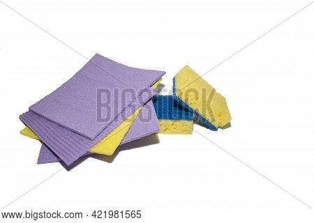 Accessories For Cleaning Washcloth On A White Background. Yellow And Purple Dishcloths And Cleaning