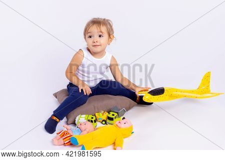 Little Smiling Cute Pretty Babygirl Looking Side, Playing With Illuminating Yellow Color Airplane. S
