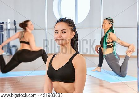Trainer Instructor In Gym Pole Dancing Studio For Fitness, Young European Woman In Front Of Women Gy