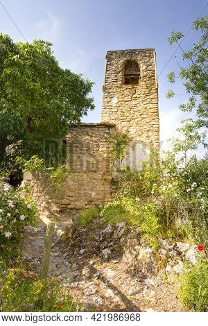 Foradada, Spain, May 1, 2020 - Old Medieval Bell Tower Near Castle Of Montsonis In Lleida Province,