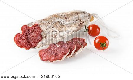 Spanish Sausage Longaniza Whole And Slices And Two Cherry Tomatoes Isolated On White Background. Dry