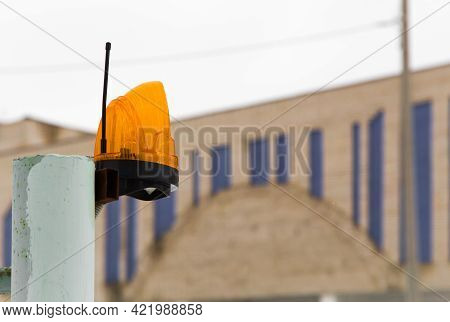 Alarm Beacon With Antenna For Transmitting The Alarm Signal On The Pipe. Signal Lamp On A Metal Pole