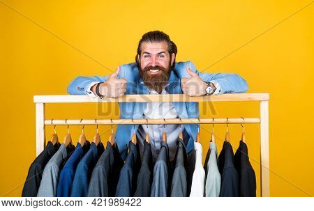 Feel Extraordinary. Bearded Hipster Use Apparel In Male Atelier. Male Wardrobe Concept. Brutal Hands