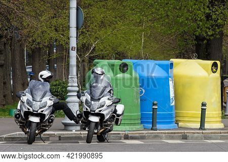 Bucharest, Romania - April 15, 2021: Two Policemen Sitting On Bmw R 1200 Rt Authority Motorcycles, T